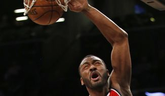 Washington Wizards' guard John Wall (2) is all by himself as he dunks in the first half of an NBA basketball game against the Brooklyn Nets, Monday, Dec. 5, 2016, in New York. (AP Photo/Kathy Willens)