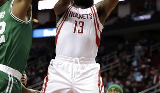 Houston Rockets' James Harden (13) goes up for a shot as Boston Celtics' Al Horford, left, defends during the first quarter of an NBA basketball game, Monday, Dec. 5, 2016, in Houston. (AP Photo/David J. Phillip)
