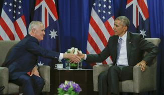 U.S. President Barack Obama shakes hands with Australia's Prime Minister Malcolm Turnbull during their meeting at the Asia-Pacific Economic Cooperation (APEC), in Lima, Peru, Sunday, Nov. 20, 2016. (AP Photo/Pablo Martinez Monsivais)