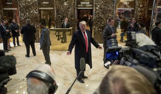 President-elect Donald Trump speaks to members of the media in the lobby of Trump Tower in New York, Tuesday, Dec. 6, 2016. (AP Photo/Andrew Harnik)