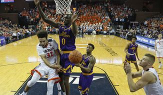 Virginia guard London Perrantes (32) makes a pass to Virginia center Jack Salt, right, as East Carolina forward Deng Riak (0) and East Carolina guard B.J. Tyson, center right, defend during the second half of an NCAA college basketball game in Charlottesville, Va., Tuesday, Dec. 6, 2016. Virginia won the game 76-54. (AP Photo/Steve Helber)