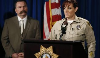 Metropolitan Police Capt. Roxanne McDaris speaks about 13-year-old Fabriccio Patti, who was fatally shot while attempting to rob a Las Vegas smoke shop, during a press conference at Metropolitan Police Department headquarters, on Tuesday, Dec. 6, 2016 in Las Vegas. (David Guzman/Las Vegas Review-Journal via AP)