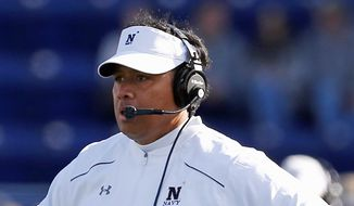 Ken Niumatalolo seeks to lead Navy to its 15th straight win over Army on Saturday. (Associated Press)