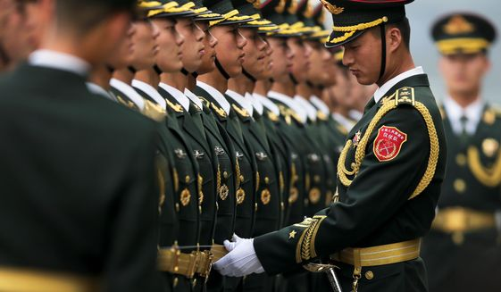 A Rand Corp. report on China's military made public this week identifies key military capabilities, including drones, hypersonic glide vehicles, stealth jets, aircraft carriers and long-range ballistic and cruise missiles. (Associated Press)