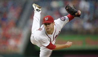 FILE - In a June 28, 2016 file photo, Washington Nationals starting pitcher Lucas Giolito follows through on a pitch during the first inning of a baseball game against the New York Mets, in Washington. On Wednesday, Dec. 7, 2016, the Washington Nationals acquired center fielder Adam Eaton from the Chicago White Sox for three young pitchers, including top prospect Giolito and hard-throwing Reynaldo Lopez, who made the team's postseason roster in 2016. (AP Photo/Nick Wass, File)