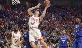 Nebraska's Michael Jacobson (12) goes for a basket against Creighton's Cole Huff (13) with Jordy Tshimanga (32), Maurice Watson Jr. (10) and Justin Patton (23) watching, during the first half of an NCAA college basketball game in Lincoln, Neb., Wednesday, Dec. 7, 2016. (AP Photo/Nati Harnik)