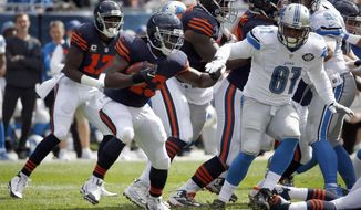 FILE - In this Oct. 2, 2016, file photo, Chicago Bears running back Joique Bell (43) runs against Detroit Lions defensive end Kerry Hyder (61) during the first half of an NFL football game in Chicago. Desperate for depth in the backfield, the Detroit Lions brought back Joique Bell after cutting him in February. They might need Bell to play Sunday against Chicago, which cut him last month. (AP Photo/Nam Y. Huh)