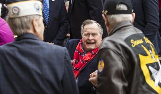 Former President George H.W. Bush greets World War II veterans at the conclusion of Pearl Harbor remembrance ceremony at the George Bush Presidential Library, Wednesday, Dec. 7, 2016, in College Station, Texas. (Brett Coomer/Houston Chronicle via AP)