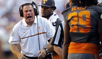 FILE - In this Sept. 24, 2016, file photo, Tennessee head coach Butch Jones yells to his players during the second half of an NCAA college football game against Florida in Knoxville, Tenn. The upcoming bowl games give the Southeastern Conference a chance to earn redemption after a disappointing regular season. (AP Photo/Wade Payne, File)