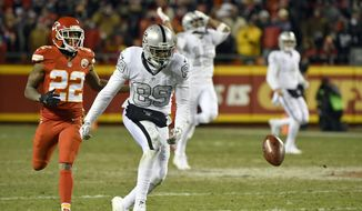 Oakland Raiders wide receiver Amari Cooper (89) can't reach a pass from quarterback Derek Carr with Kansas City Chiefs defensive back Marcus Peters (22) running behind him, during the second half of an NFL football game in Kansas City, Mo., Thursday, Dec. 8, 2016. (AP Photo/Ed Zurga)