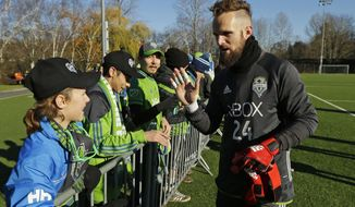 In this Dec. 7, 2016, Seattle Sounders goalkeeper Stefan Frei greets fans after training in Tukwila, Wash. The Sounders are scheduled to face Toronto FC in the MLS Cup on Saturday, Dec. 10, 2016, in Toronto. (AP Photo/Ted S. Warren)
