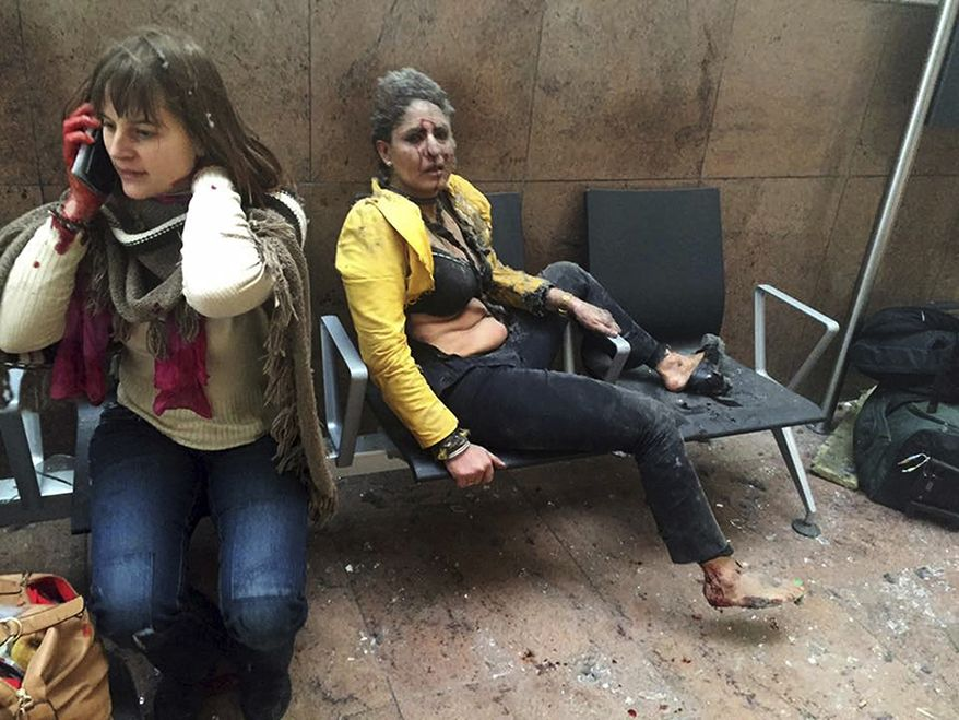 In this photo provided by Georgian Public Broadcaster and photographed by Ketevan Kardava, Nidhi Chaphekar, a 40-year-old Jet Airways flight attendant from Mumbai, right, and another unidentified woman are shown after being wounded in Brussels Airport in Brussels, Belgium, after explosions rocked the airport on March 22, 2016. (Ketevan Kardava/Georgian Public Broadcaster via AP, File)