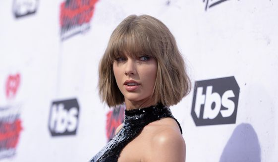 """In this April 3, 2016, file photo, Taylor Swift arrives at the iHeartRadio Music Awards at The Forum in Inglewood, Calif. Swift has teamed with former One Direction singer Zayn Malik for the surprise duet, """"I Don't Wanna Live Forever"""" released on Friday, Dec. 9, 2016. (Photo by Richard Shotwell/Invision/AP, File)"""