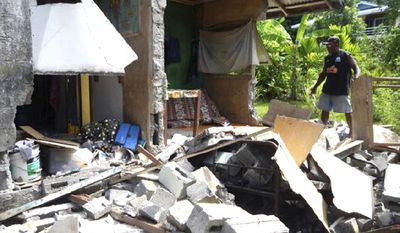 In this photo provided by World Vision Solomon Islands, a house in Kirakira, Solomon Islands, is damaged after an earthquake on Friday, Dec. 9, 2016. Tsunami warnings for several Pacific islands, including those in Hawaii, were canceled Friday after authorities determined that a powerful magnitude 7.7 earthquake that struck near the Solomon Islands did not pose a broad tsunami threat. (Gray Nako/World Vision Solomon Islands via AP)