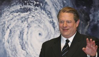 "In this Jan. 15, 2007, file photo, former Vice President Al Gore acknowledges spectators in front of a poster of his starring documentary film ""An Inconvenient Truth"" on global warming before its screening during the Japan Premier at a theater in Tokyo.  (AP Photo/Koji Sasahara, File)"
