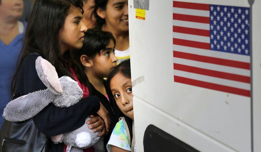 Immigrants from El Salvador and Guatemala who entered the country illegally board a bus after they were released from a family detention center in San Antonio, Texas. (Associated Press)