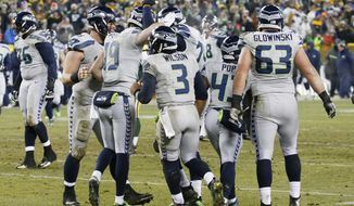 Seattle Seahawks' Tanner McEvoy (19) is congratulated after catching a touchdown pass during the second half of an NFL football game against the Green Bay Packers Sunday, Dec. 11, 2016, in Green Bay, Wis. (AP Photo/Mike Roemer)