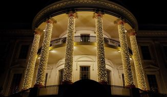 The White House South Portico is adorned with Christmas lights Sunday, Dec. 11, 2016, in Washington. (AP Photo/Manuel Balce Ceneta)