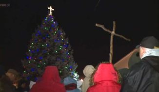 Residents of Knightstown, Indiana, held a vigil Sunday night to protest the ACLU's lawsuit against the cross on top of the town's Christmas tree.