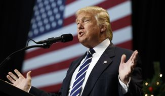 President-elect Donald Trump speaks during a Wisconsin rally in mid-December. (AP Photo/Evan Vucci)