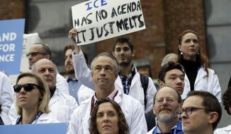 Scientists hold signs during a rally in conjunction with the American Geophysical Union's fall meeting Tuesday, Dec. 13, 2016, in San Francisco. The rally was to call attention to what scientist believe is unwarranted attacks by the incoming Trump administration against scientists advocating for the issue of climate change and its impact. (AP Photo/Marcio Jose Sanchez) **FILE**