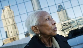 In this Jan. 11, 2016, file photo, Doris Payne poses for a photo in Atlanta. Police just outside Atlanta say a notorious 86-year-old jewel thief has struck again. Dunwoody, Ga., police say Payne was arrested Tuesday, Dec. 13, 2016, at a Von Maur department store where police report she put a $2,000 necklace in her back pocket and tried to leave the store. (AP Photo/John Bazemore, File)
