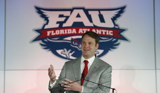 Lane Kiffin gestures as he speaks after being introduced as the new Florida Atlantic head football coach, Tuesday, Dec. 13, 2016, in Boca Raton, Fla. The school announced the move on Twitter on Tuesday, a day after Alabama coach Nick Saban said his offensive coordinator was leaving to take over the Owls. It's the fourth opportunity for Kiffin to be a head coach, after an NFL stint with the Oakland Raiders and college ones at Tennessee and USC. (AP Photo/Wilfredo Lee)