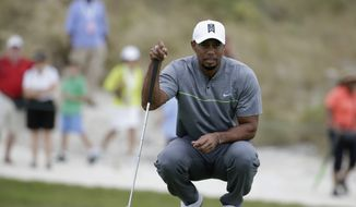 Tiger Woods lines up a putt during the third round at the Hero World Challenge golf tournament, Saturday, Dec. 3, 2016, in Nassau, Bahamas. (AP Photo/Lynne Sladky) ** FILE **