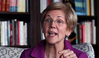 "Sen. Elizabeth Warren said ""the only way for President-elect Trump to truly eliminate conflicts-of-interest is to divest his financial interests and place them in a blind trust."" (Associated Press)"