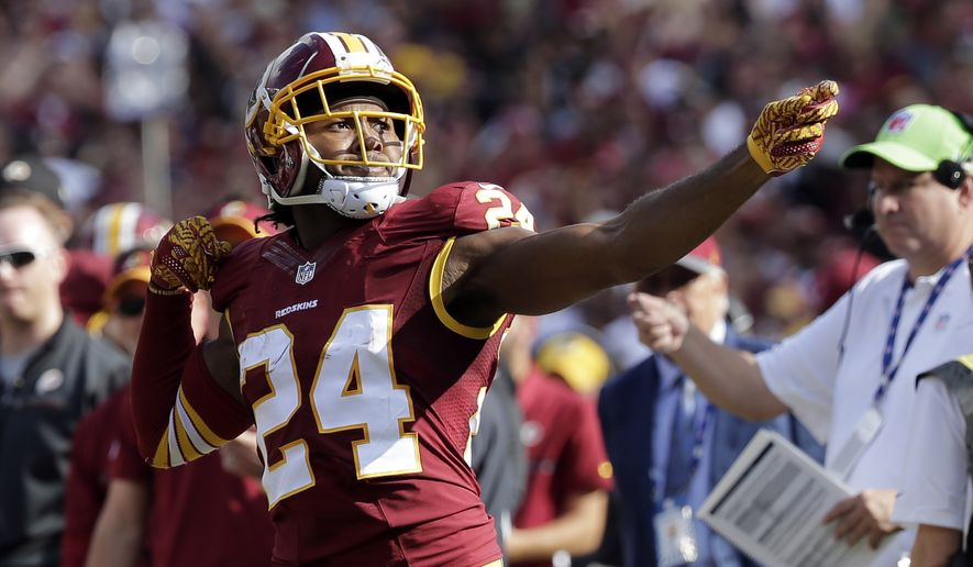 """FILE - In this Oct. 2, 2016, file photo, Washington Redskins cornerback Josh Norman (24) celebrates his interception with a """"bow and arrow,"""" gesture during the second half of an NFL football game against the Cleveland Browns in Landover, Md. (AP Photo/Chuck Burton, File) **FILE**"""