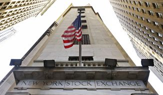 In this Friday, Nov. 13, 2015, file photo, the American flag flies above the Wall Street entrance to the New York Stock Exchange. (AP Photo/Richard Drew, File)