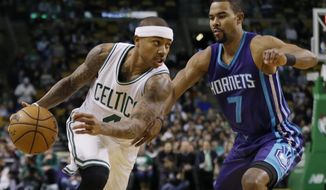 Boston Celtics guard Isaiah Thomas (4) drives against Charlotte Hornets guard Ramon Sessions (7) in the first quarter of an NBA basketball game, Friday, Dec. 16, 2016, in Boston. (AP Photo/Elise Amendola)