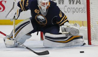 Buffalo Sabres goalie Robin Lehner (40) makes a save during the second period of an NHL hockey game against the New York Islanders, Friday, Dec. 16, 2016, in Buffalo, N.Y. (AP Photo/Jeffrey T. Barnes)