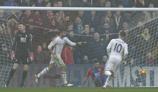 Chelsea's Diego Costa, centre, celebrates after scoring the opening goal during the English Premier League soccer match between Crystal Palace and Chelsea at Selhurst Park stadium in London, Saturday Dec. 17, 2016. (AP Photo/Matt Dunham)