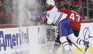 Washington Capitals right wing Tom Wilson (43) escapes a check from Montreal Canadiens defenseman Alexei Emelin (74) of Russia, during the second period of an NHL hockey game in Washington, Saturday, Dec. 17, 2016. (AP Photo/Manuel Balce Ceneta)