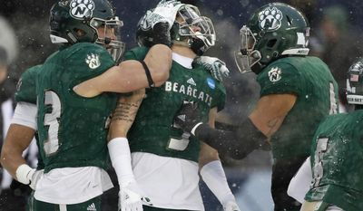 Northwest Missouri State cornerback Jack Young (5) celebrates with Jacob Vollstedt (43) and Kyle Goodburn (4) after intercepting a pass in the end zone against North Alabama in the first half of an NCAA Division II championship football game Saturday, Dec. 17, 2016, in Kansas City, Kan. (AP Photo/Colin E. Braley)