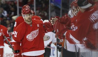 Detroit Red Wings left wing Tomas Tatar (21) celebrates his goal against the Anaheim Ducks in the first period of an NHL hockey game Saturday, Dec. 17, 2016, in Detroit. (AP Photo/Paul Sancya)