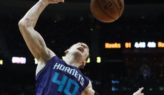 Charlotte Hornets center Cody Zeller (40) scores against the Atlanta Hawks in the second half of an NBA basketball game Saturday, Dec. 17, 2016, in Atlanta. Charlotte won 107-99. (AP Photo/John Bazemore)