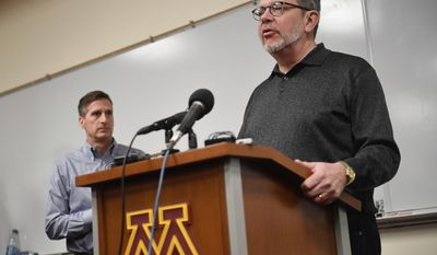 University of Minnesota President Eric Kaler speaks to the media after players announced the end of their boycott of the Holiday Bowl minutes before as Athletic Director Mark Coyle stood behind, Saturday, Dec. 17, 2016 at the Gibson-Nagurski Football Complex in Minneapolis, Minn. (Aaron Lavinsky/Star Tribune via AP)