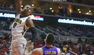 Iowa forward Ahmad Wagner puts a shot up over Northern Iowa forward Klint Carlson during the first half of an NCAA college basketball game, Saturday, Dec. 17, 2016, in Des Moines, Iowa. (AP Photo/Justin Hayworth)