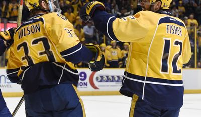 Nashville Predators' Mike Fisher  celebrates his goal with teammate Colin Wilson (33) during the second period of an NHL hockey game against the New York Rangers, Saturday, Dec. 17, 2016, in Nashville, Tenn. (AP Photo/Sanford Myers)