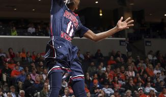 Robert Morris guard Dachon Burke (11) dunks during the team's NCAA college basketball game against Virginia on Saturday Dec. 17, 2016, in Charlottesville, Va. (AP Photo/Andrew Shurtleff)