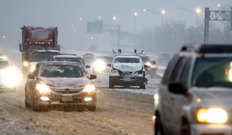 A vehicle involved in a crash sits on the fast lane of Highway Interstate 80 after an accident during a snowfall, Saturday, Dec. 17, 2016, in Lodi, N.J. (AP Photo/Julio Cortez)