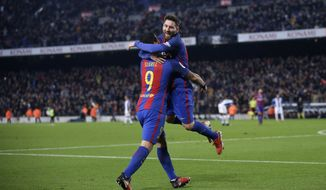 FC Barcelona's Lionel Messi, right, celebrates after scoring with his teammate Luis Suarez during the Spanish La Liga soccer match between FC Barcelona and Espanyol at the Camp Nou in Barcelona, Spain, Sunday, Dec. 18, 2016. (AP Photo/Manu Fernandez)