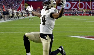 New Orleans Saints running back Tim Hightower (34) celebrates his touchdown against the Arizona Cardinals during the second half of an NFL football game, Sunday, Dec. 18, 2016, in Glendale, Ariz. (AP Photo/Ross D. Franklin)