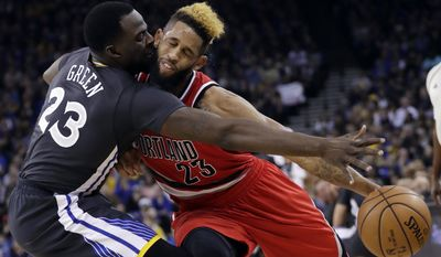 Portland Trail Blazers' Allen Crabbe, right, is fouled by Golden State Warriors' Draymond Green, left, during the first half of an NBA basketball game Saturday, Dec. 17, 2016, in Oakland, Calif. (AP Photo/Marcio Jose Sanchez)