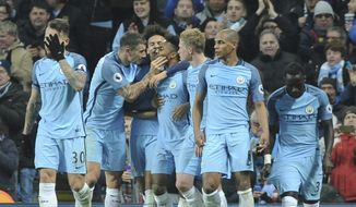Manchester City's players celebrate after Raheem Sterling, 3rd left, scored during the English Premier League soccer match between Manchester City and Arsenal at the Etihad Stadium in Manchester, England, Sunday, Dec. 18, 2016. (AP Photo/Rui Vieira)