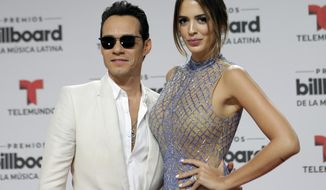 FILE- In this April 28, 2016, file photo, singer Marc Anthony and his wife Shannon de Lima arrive at the Latin Billboard Awards in Coral Gables, Fla. Anthony and his wife announced Sunday, Dec. 18, that they are divorcing after a two-year marriage. (AP Photo/Alan Diaz, File)