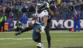 The ball bounces off of Philadelphia Eagles wide receiver Jordan Matthews (81) under pressure from Baltimore Ravens defensive back Jerraud Powers (26) during a failed two point conversion attempt during the second half of an NFL football game in Baltimore, Sunday, Dec. 18, 2016. The Ravens defeated the Eagles 27-26. (AP Photo/Nick Wass)