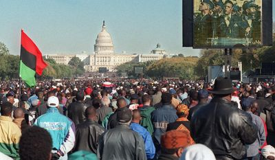 FILE - In this Oct. 16, 1995 file photo, a video screen shows Nation of Islam leader Louis Farrakhan speaking during the Million Man March at the Mall in Washington. The Capitol is seen in the background. Two decades later, the march Farrakhan organized, which drew hundreds of thousands to Washington, remains a cultural touchstone. (AP Photo/Steve Helber)